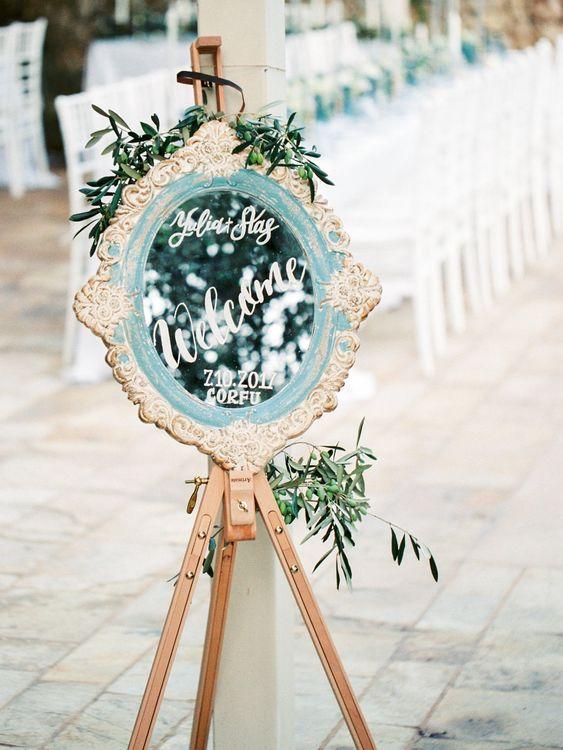 Mirror Welcome Sign on Easel  | Pastel Blue & Green, Romantic, Destination Wedding at Corfu Luxury Villas, Planned by Rosmarin Weddings & Events | Mikhail Balygin Fine Art Wedding Photographer