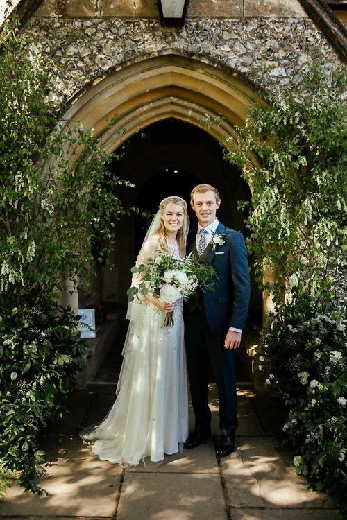 Floral & Foliage Installation At Church // Juliet Cap Veil For A Wildflower Filled Wedding At Chenies Manor // Bride In Apache By Jenny Packham // Image By Eneka Stewart Photography