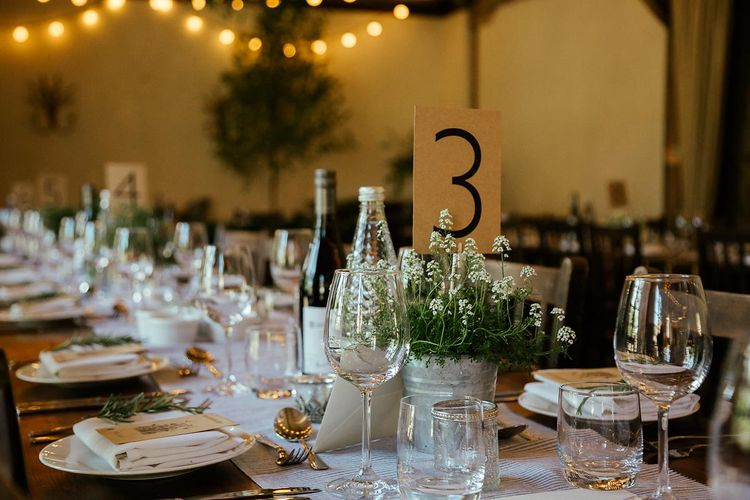 Potted Plant Table Centrepieces // Juliet Cap Veil For A Wildflower Filled Wedding At Chenies Manor // Bride In Apache By Jenny Packham // Image By Eneka Stewart Photography