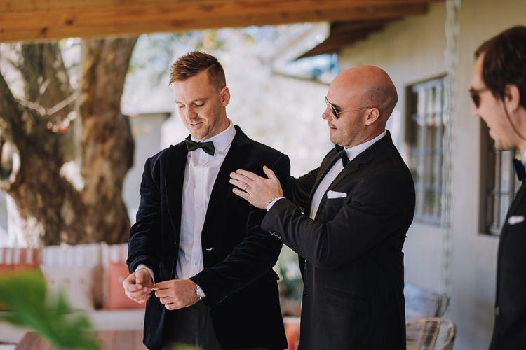 Groom and Groomsmen In Black Tuxedo For Wedding