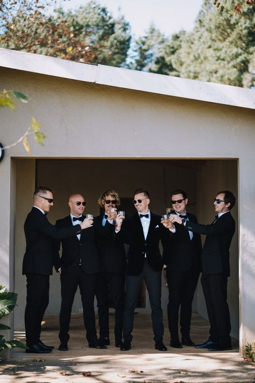 Groomsmen Wear Tuxedos For Black Tie Wedding