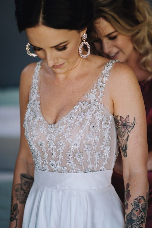 Wedding Dress Embellished With Flower Detail For Wedding With DIY Decor and Polaroid Guest Book