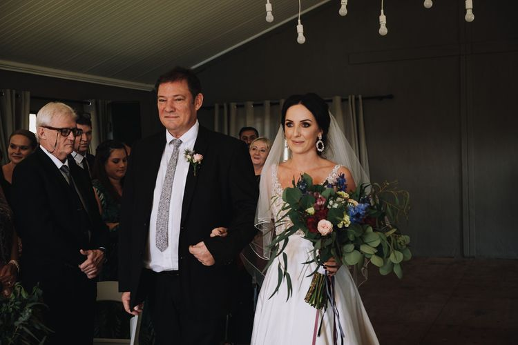 Father Of The Bride Walks Daughter Up The Aisle While She Holds Beautiful  Bouquet
