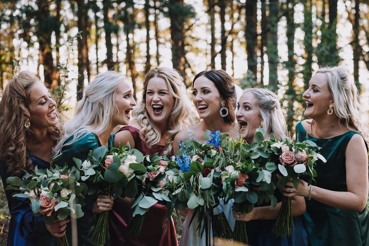 Bridal Party In Different Coloured Bridesmaid Dresses With Bouquets