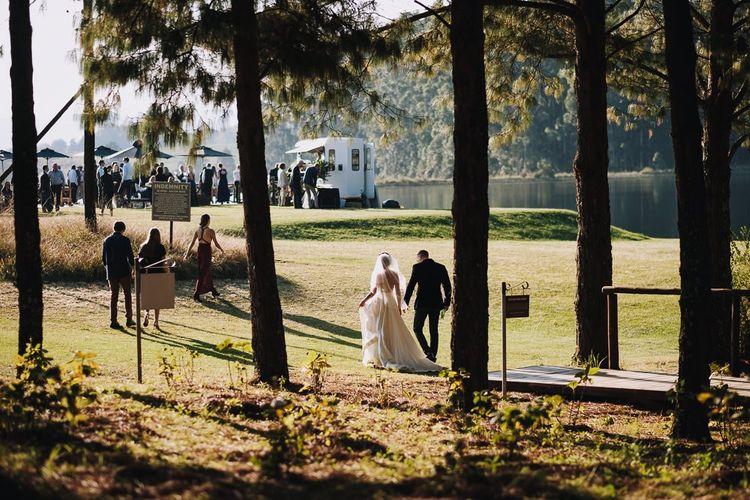 Bride And Groom Walk Up To Haycroft Farm Wedding Venue