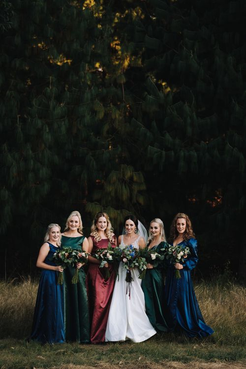 Bridal Party In Different Coloured Bridesmaid Dresses