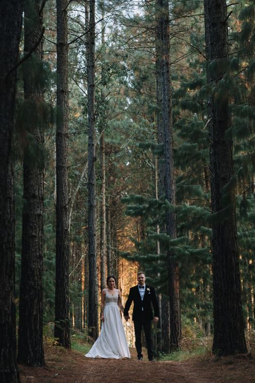 Bride and Groom Walk Through Forest In South Africa