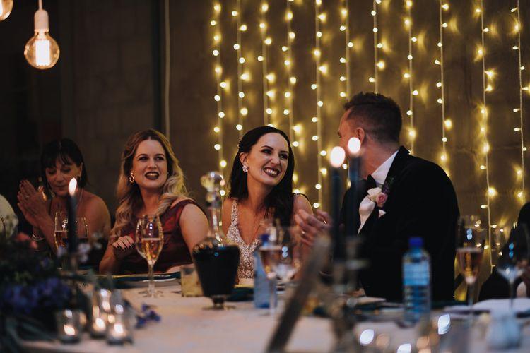 Bride and Groom Enjoy Wedding Speeches Alongside Polaroid Guest Book