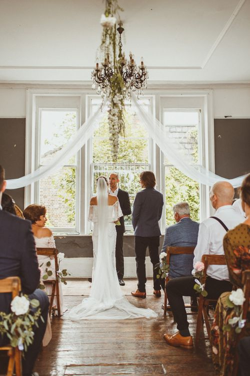 Intimate Wedding Ceremony with Bride and Groom at the Altar