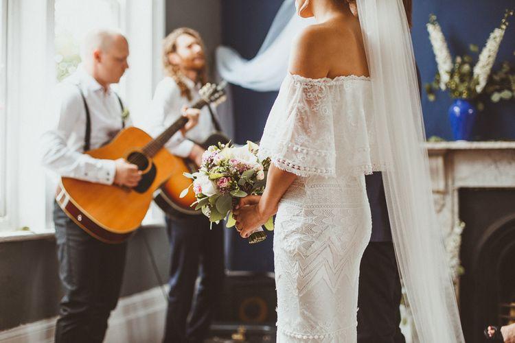 Bride at the Altar in Off the Shoulder 'Emanuela' Grace Loves Lace Wedding Dress and Long Veil
