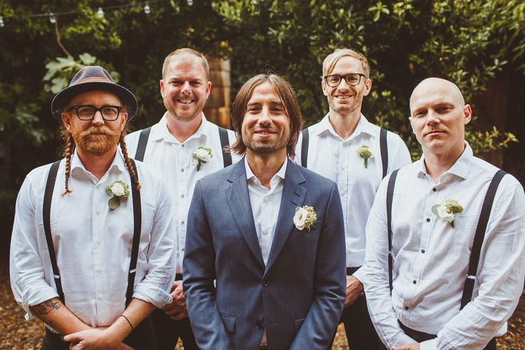 Groom in White Shirt and Blue Blazer and Groomsmen in White Shirt and Braces