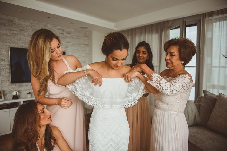 Bride Getting Ready into a Grace Loves Lace Dress on Morning
