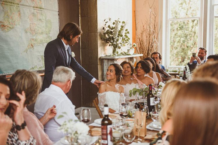 Groom in Black Trousers, White Shirt and Blue Blazer Reading His Wedding Speech