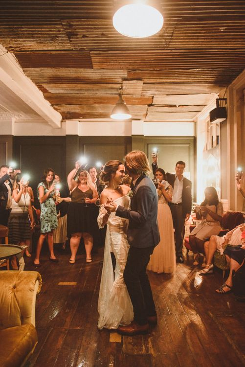 Bride in Off The Shoulder Grace Loves Lace Dress and Groom in Blue Blazer  During First Dance