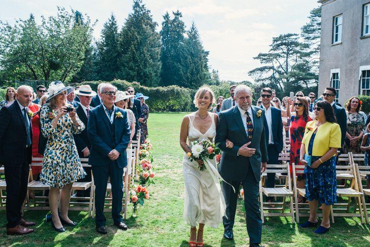Entrance of the Bride | Bride in Racerback Alexander Wang Wedding Dress | Colourful Pennard House Wedding | Allison Dewey Photography