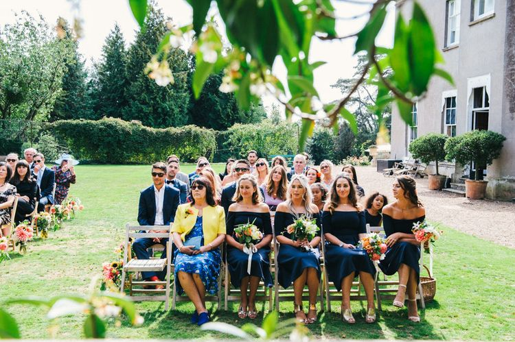 Wedding Ceremony | Bridesmaids in Navy ASOS Dresses | Bright Bouquets of Dahlias | Colourful Pennard House Wedding With Bride Wearing Racerback Alexander Wang Dress | Allison Dewey Photography
