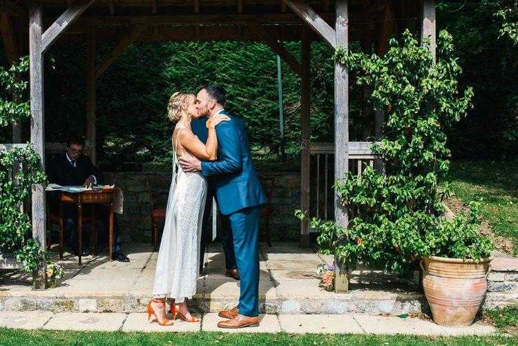 Wedding Ceremony | Bride in Racerback Alexander Wang Wedding Dress | Groom in Blue Ted Baker Suit | Colourful Pennard House Wedding | Allison Dewey Photography