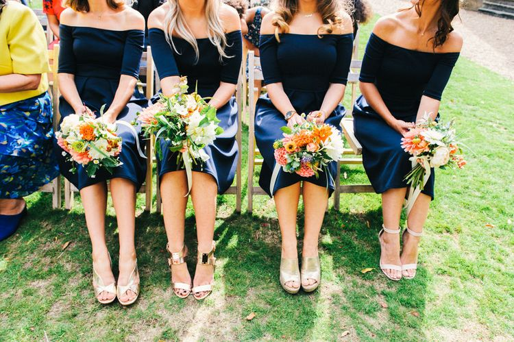 Wedding Ceremony | Bridesmaids in Navy ASOS Dresses | Bright Bouquets of Dahlias | Colourful Pennard House Wedding With Bride Wearing Racerback Dress | Allison Dewey Photography