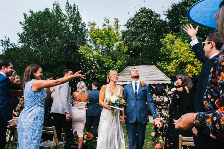 Confetti Moment | Bride in Racerback Alexander Wang Wedding Dress | Groom in Blue Ted Baker Suit | Colourful Pennard House Wedding | Allison Dewey Photography