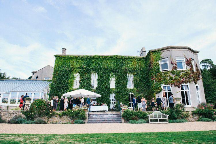 Wedding Reception | Colourful Pennard House Wedding With Bride Wearing Racerback Dress | Allison Dewey Photography