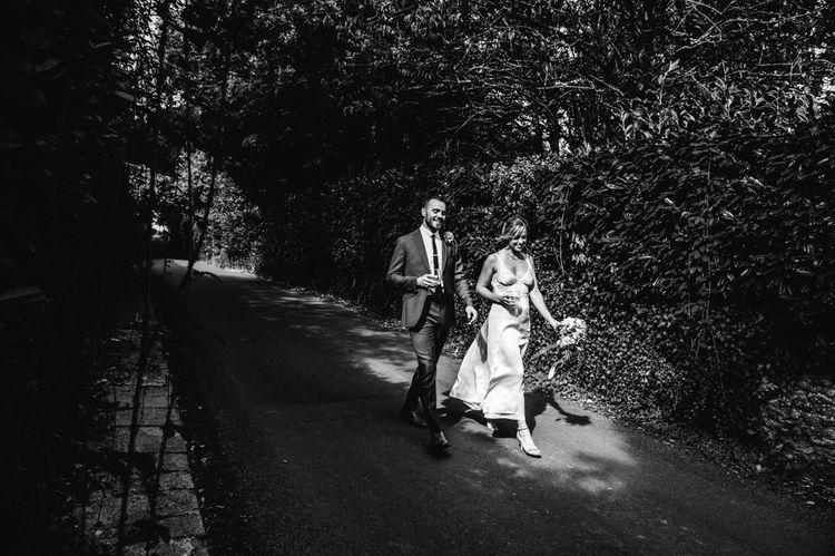 Bride in Racerback Alexander Wang Wedding Dress | Groom in Blue Ted Baker Suit | Colourful Pennard House Wedding With Bride Wearing Racerback Dress | Allison Dewey Photography