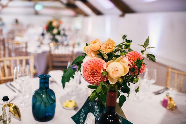 Wedding Reception | Bright Dahlias in Jar | Wedding Breakfast Menu | Colourful Pennard House Wedding With Bride Wearing Racerback Dress | Allison Dewey Photography