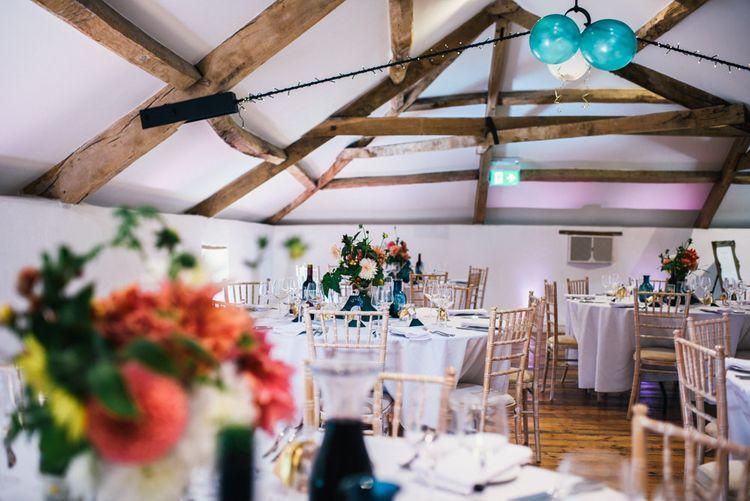 Wedding Reception | Bright Dahlias in Jar | Colourful Pennard House Wedding With Bride Wearing Racerback Dress | Allison Dewey Photography
