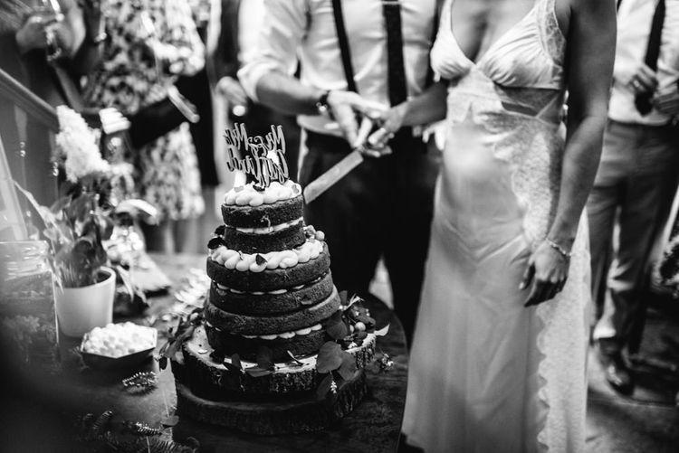 Wedding Cake | Cutting of Cake | Bride in Racerback Alexander Wang Wedding Dress | Colourful Pennard House Wedding With Bride Wearing Racerback Dress | Allison Dewey Photography