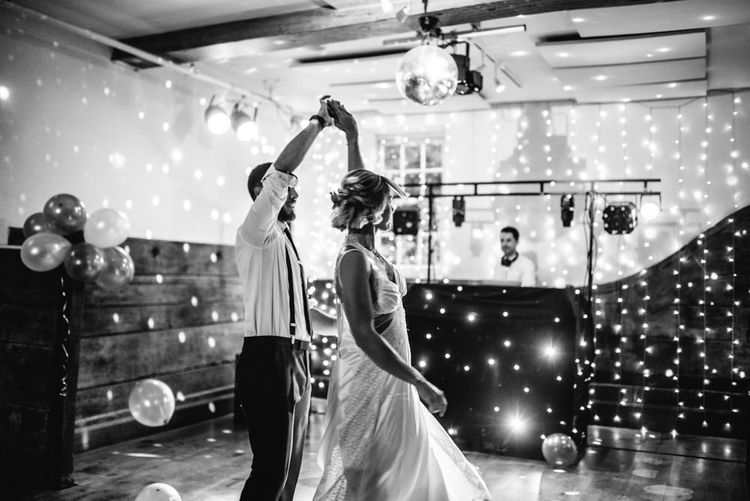 First Dance | Bride in Racerback Alexander Wang Wedding Dress | Groom in Blue Ted Baker Suit | Colourful Pennard House Wedding With Bride Wearing Racerback Dress | Allison Dewey Photography