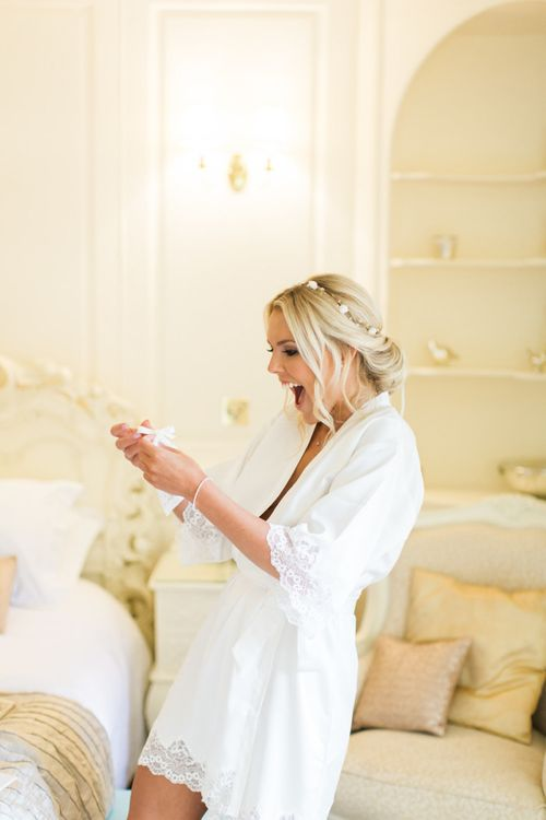 Wedding Morning Bridal Preparations with Bride in White Satin Getting Ready Robe