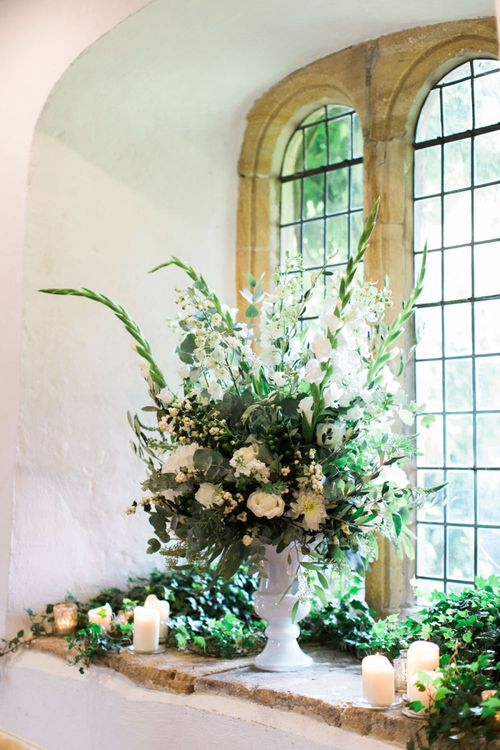 Foliage and White Flower Floral Arrangement