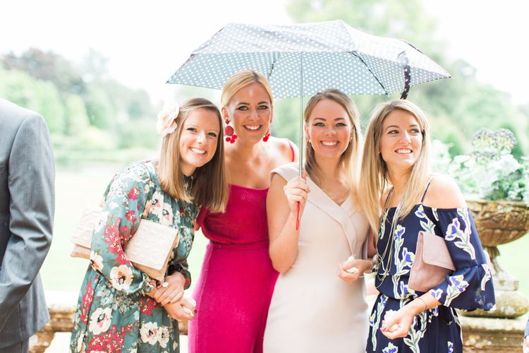 Beautiful Female Wedding Guests in Floral Dresses