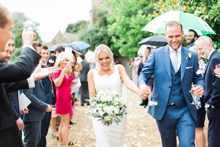 Confetti Moment  with Bride in Lace St Patrick Wedding Dress and Groom in Blue Reiss Suit