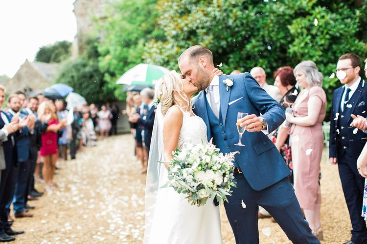 Confetti Exit with Bride in Lace St Patrick Wedding Dress and Groom in Blue Reiss Suit