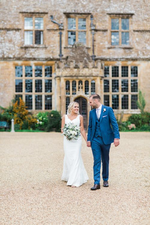 Bride in St Patrick La Sposa Wedding Dress and Groom in Blue Reiss Suit