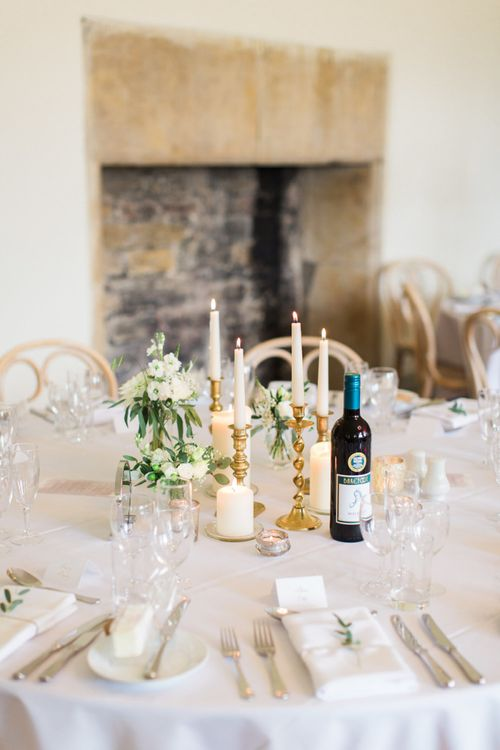 Gold Candlesticks and Taper Candles Centrepiece