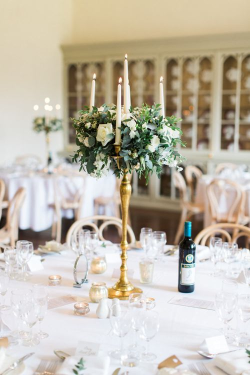 Gold Candelabra Tabel Centrepiece with White Flowers and Foliage