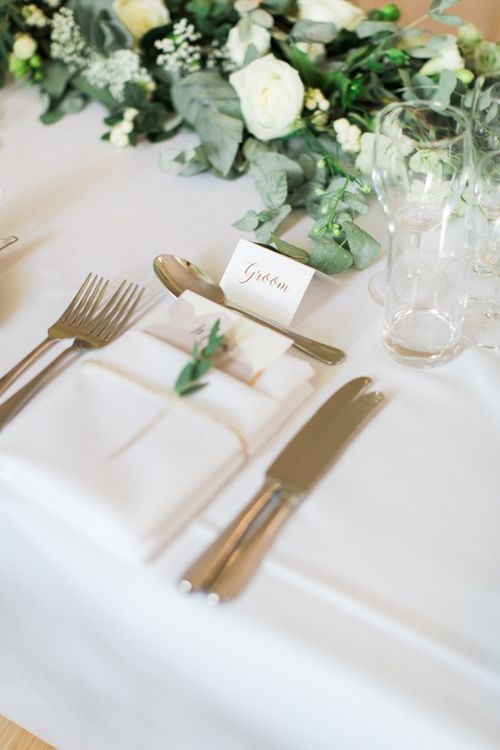 Elegant Place Setting with Folded Napkin and Foliage Stem