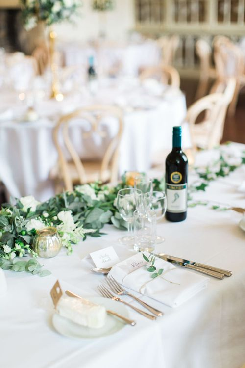 Elegant Place Setting and White Flower and Foliage Garland