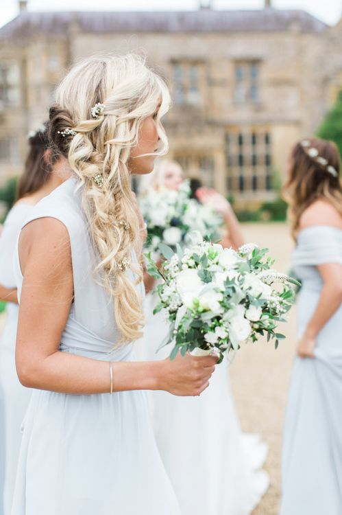 Bridesmaid in Grey  TFNC Dress with Side Braid Hairstyle and Green and White Bouquet