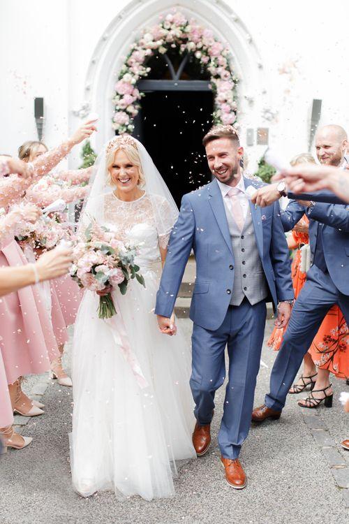 Confetti exit at Didsbury House Hotel wedding
