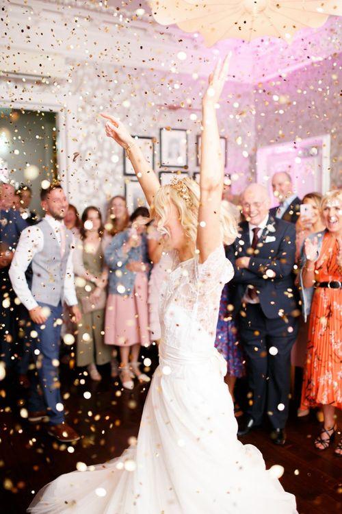 Bride dances in confetti