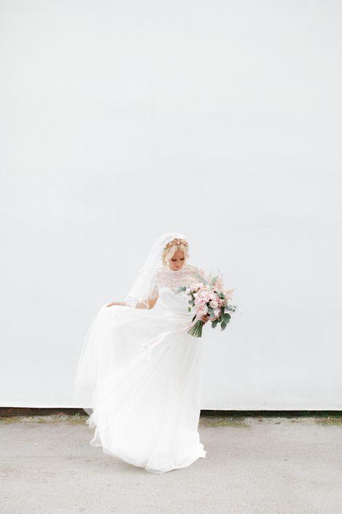 Bride in lace Halfpenny London wedding dress