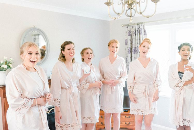 Bridesmaids on Wedding Morning in Matching Blush Pink Getting Ready Robes