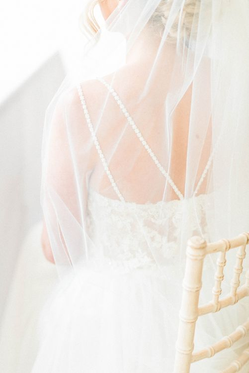 Bride in Lace Wedding Dress with Spaghetti Straps and Cathedral Veill