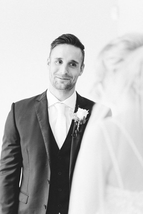 Groom at the Altar Looking Lovingly at His Bride