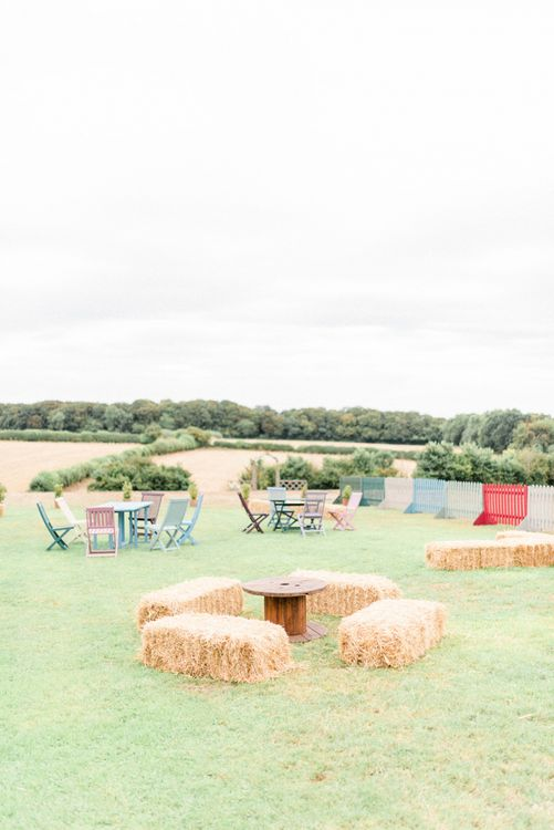 Outdoor Seating Area with Hay Bales and Benches