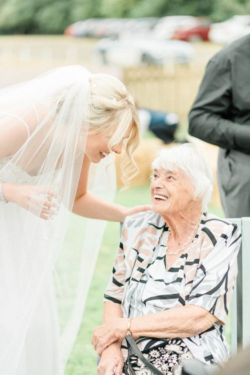 Bride and Name Talking at Drinks Reception