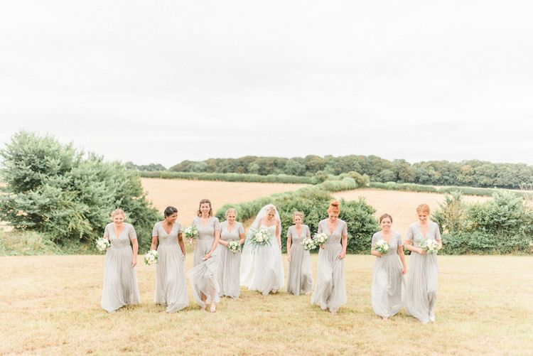 Bridal Party Portrait with Bridesmaids in Grey Sequin & Tulle Dresses and Bride in Romantic Wedding Dress with Straps