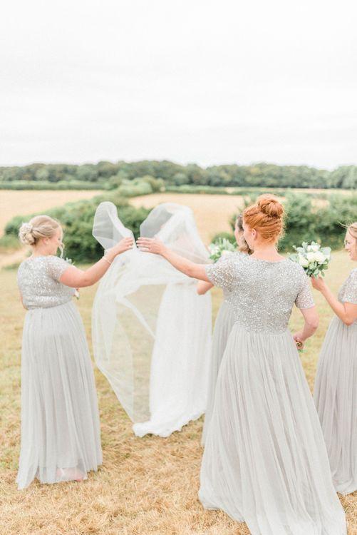 Bridesmaids in Grey Sequin & Tulle Dresses Adjusting The Brides Wedding Veil
